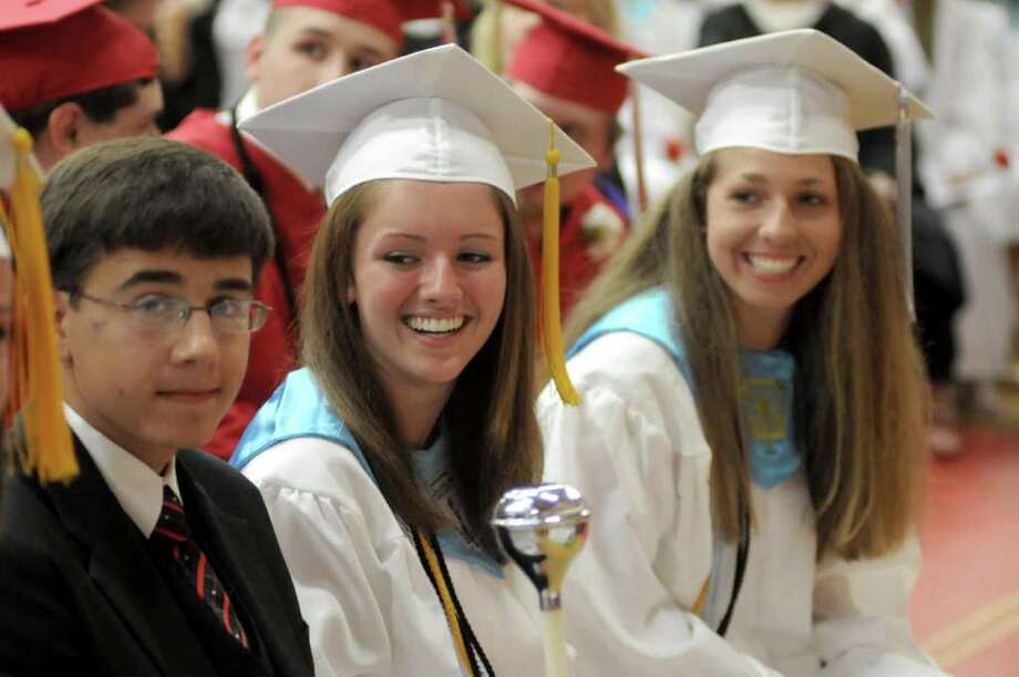 Masuk High School helds it's Graduation ceremony on Thursday June 23, 2011. Commencement ceremonies where held in the gymnasium due to rain. From left, Grand Marshall Jimmy Boivie, 17, Julia Janco, 18, and Natalie Ciancetta, 18. Photo: Lisa Weir / The News-Times Freelance