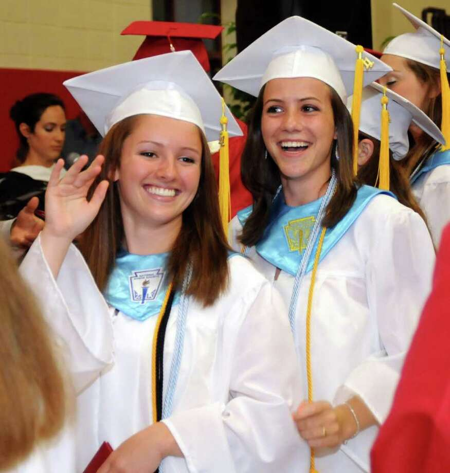 Julia Janco, left and Kathleen Snajder smile widely after receiving their diplomas at Masuk High School helds it's Graduation ceremony on Thursday June 23, 2011. Commencement ceremonies where held in the gymnasium due to rain. Photo: Lisa Weir / The News-Times Freelance
