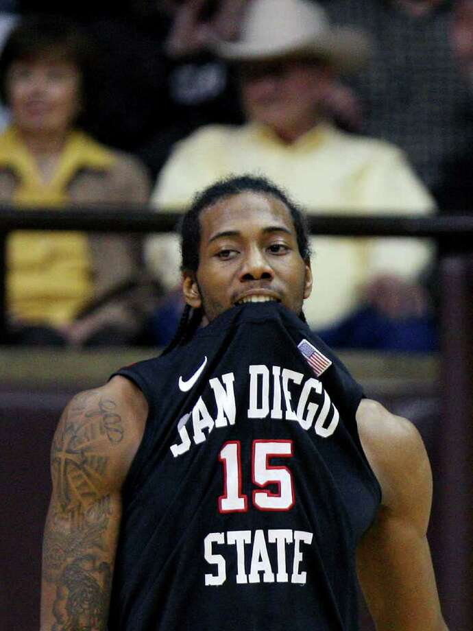 San Diego State forward Kawhi Leonard bites his jersey during an NCAA college basketball game against Wyoming on Tuesday, March 1, 2011, in Laramie, Wyo. Photo: AP