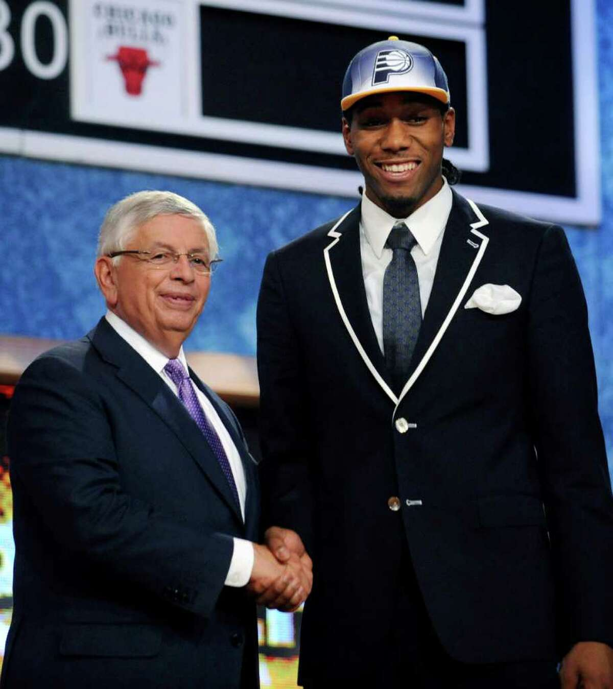 KAWHI LEONARD'S FIRST DAYS AS A SPUR1. Drafted to the Indiana Pacers then traded to the SpursPhoto: NBA Commissioner David Stern, left, poses with the No. 15 pick, San Diego State's Kawhi Leonard, who was selected by the Indiana Pacers in the NBA basketball draft Thursday, June 23, 2011, in Newark, N.J.