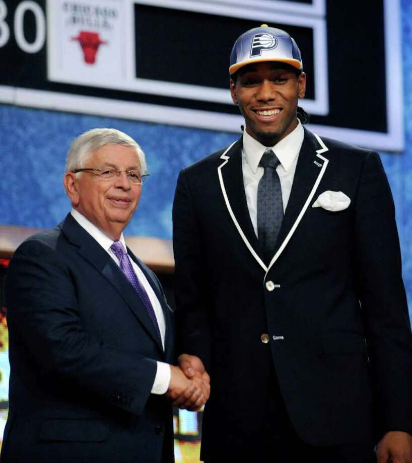 KAWHI LEONARD'S FIRST DAYS AS A SPUR1. Drafted to the Indiana Pacers then traded to the SpursPhoto: NBA Commissioner David Stern, left, poses with the No. 15 pick, San Diego State's Kawhi Leonard, who was selected by the Indiana Pacers in the NBA basketball draft Thursday, June 23, 2011, in Newark, N.J. Photo: AP