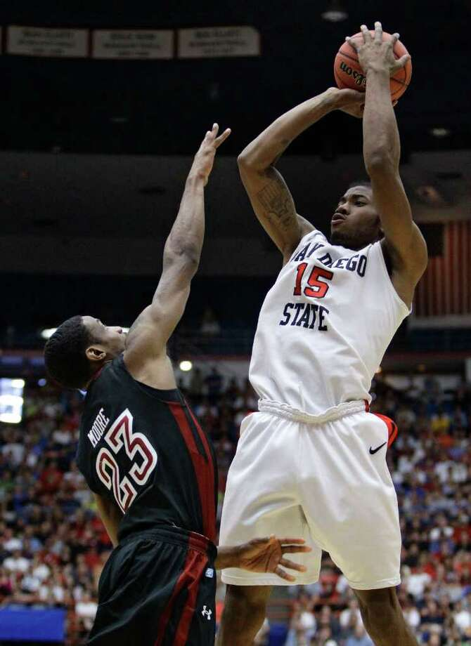 San Diego State's Kawhi Leonard (15) shoots over Temple's Ramone Moore (23) during a West Regional NCAA college basketball tournament third round game Saturday, March 19, 2011, in Tucson, Ariz. Photo: AP