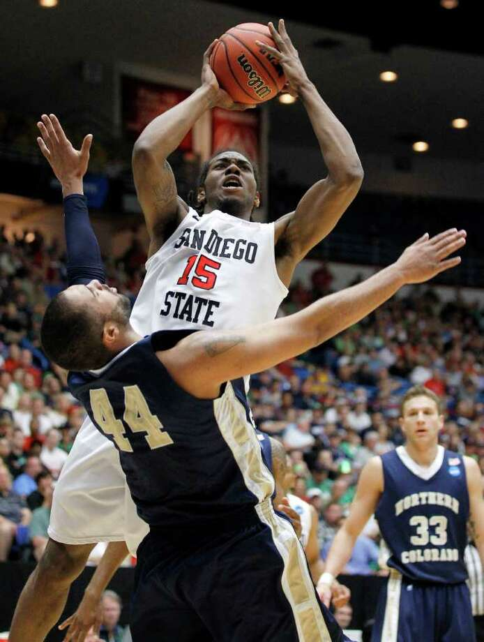 San Diego State's Kawhi Leonard (15) takes a shot over Northern Colorado's Taylor Montgomery (44) during a West Regional NCAA college basketball tournament second round game Thursday, March 17, 2011, in Tucson, Ariz. Photo: AP