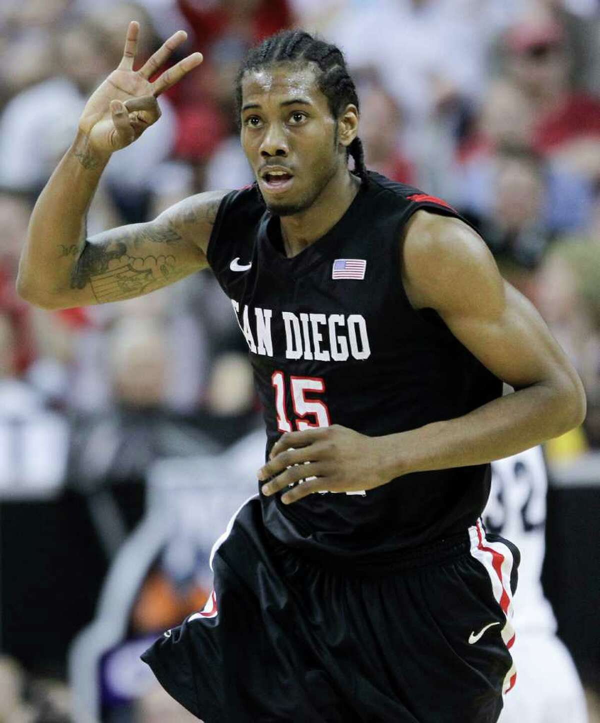 San Diego State's Kawhi Leonard gestures after hitting a three-point basket during the first half of an NCAA college basketball championship game against BYU in the Mountain West Conference tournament, Saturday, March 12, 2011, in Las Vegas. San Diego State won 72-54.