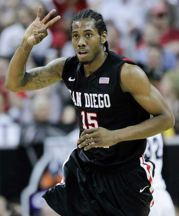 San Diego State's Kawhi Leonard gestures after hitting a three-point basket during the first half of an NCAA college basketball championship game against BYU in the Mountain West Conference tournament, Saturday, March 12, 2011, in Las Vegas. San Diego State won 72-54. Photo: AP