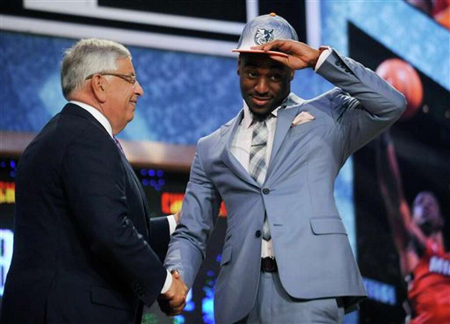 NBA Commissioner David Stern, left, poses with Connecticut's Kemba Walker, whom the Charlotte Bobcats selected with the ninth pick in the NBA basketball draft Thursday, June, 23, 2011, in Newark, N.J. (AP Photo/Bill Kostroun) Photo: AP