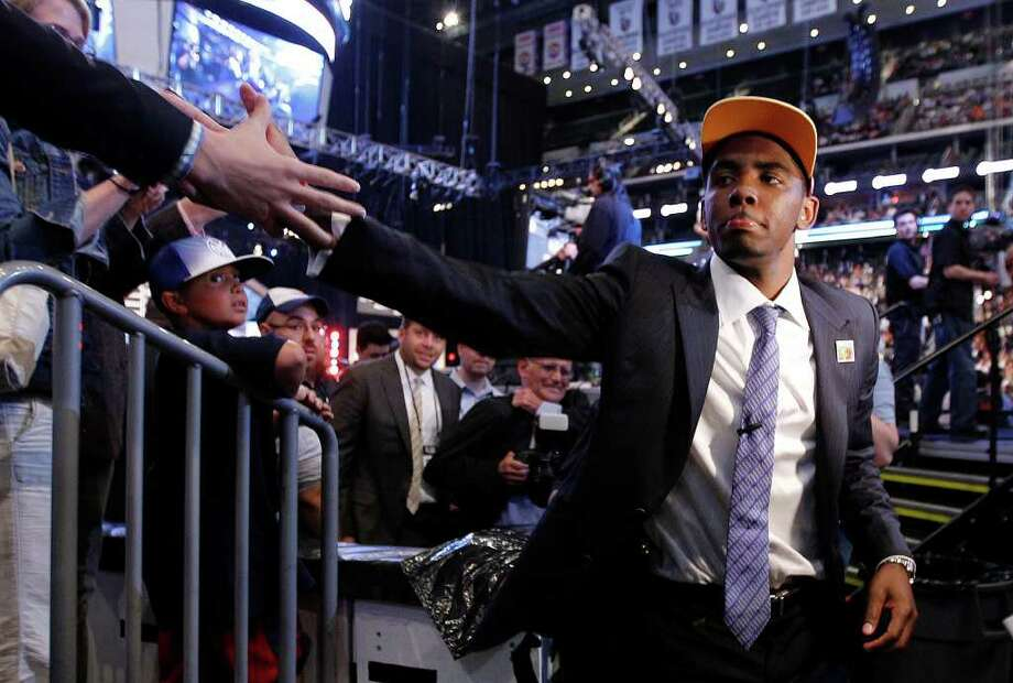 Kyrie Irving, a former Duke basketball player, is congratulated after being take with the No. 1 pick by the Cleveland Cavaliers during the NBA basketball draft, Thursday, June 23, 2011, in Newark, N.J. (AP Photo/Julio Cortez) Photo: Julio Cortez