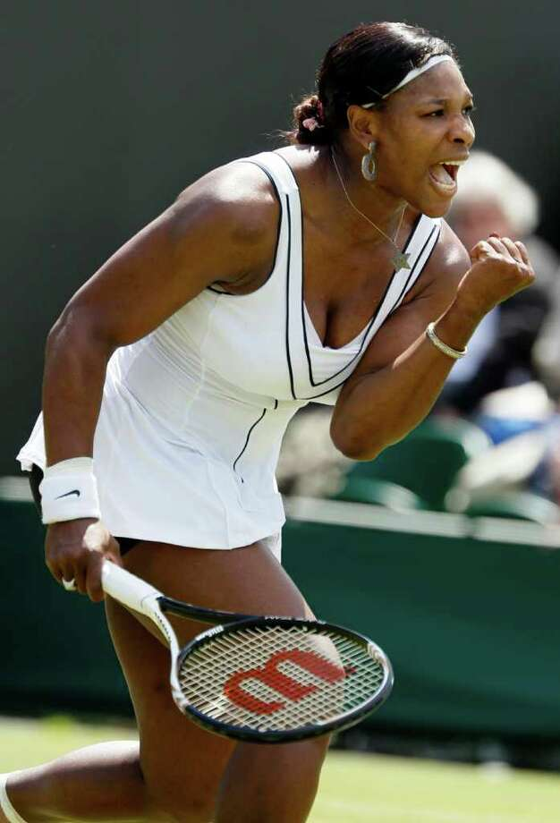 Serena Williams of the US reacts after defeating Romania's Simona Halep in their match at the All England Lawn Tennis Championships at Wimbledon, Thursday, June 23, 2011. (AP Photo/Alastair Grant) Photo: Alastair Grant