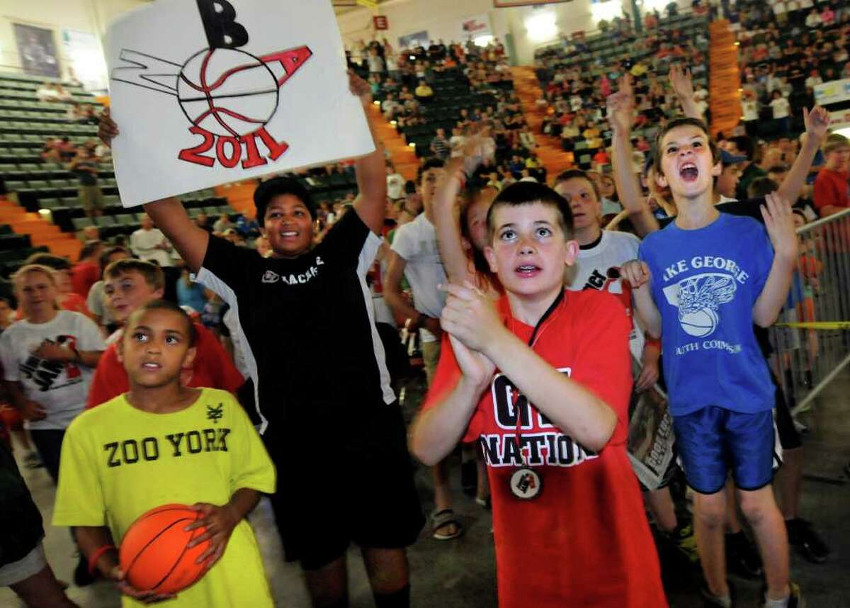 Young basketball fans cheer for Jimmer Fredette when Milwaukee selects him during the NBA draft on Thursday, June 23, 2011, at the Glens Falls Civic Center in Glens Falls, N.Y. (Cindy Schultz / Times Union)
