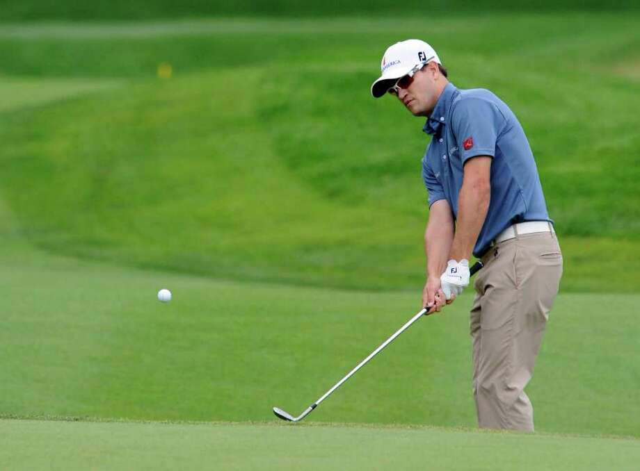Zach Johnson hits his second shot on the 15th hole during the first round of the Travelers Championship golf tournament in Cromwell, Conn., on Thursday, June 23, 2011. (AP Photo/Fred Beckham) Photo: Fred Beckham