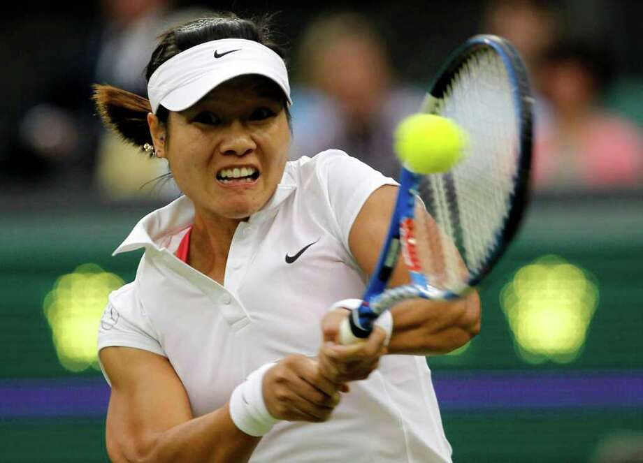 China's Li Na reacts returns a shot to Germany's Sabine Lisicki at the All England Lawn Tennis Championships at Wimbledon, Thursday, June 23, 2011. (AP Photo/Anja Niedringhaus) Photo: Anja Niedringhaus