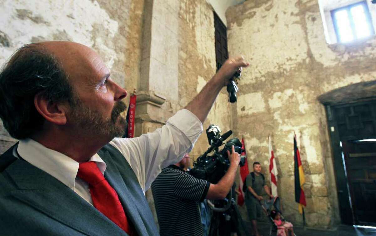 Bruce Winders, historian and curator at the Alamo, points out the location of some historical graffiti.