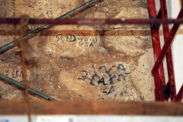 These markings, believed to be from the Civil War era, were uncovered by Alamo conservator Pam Jary Rosser. Officials think the marks might have been made by a member of the secretive Knights of the Golden Circle. Photo: Tom Reel/treel@express-news.net / © 2011 San Antonio Express-News