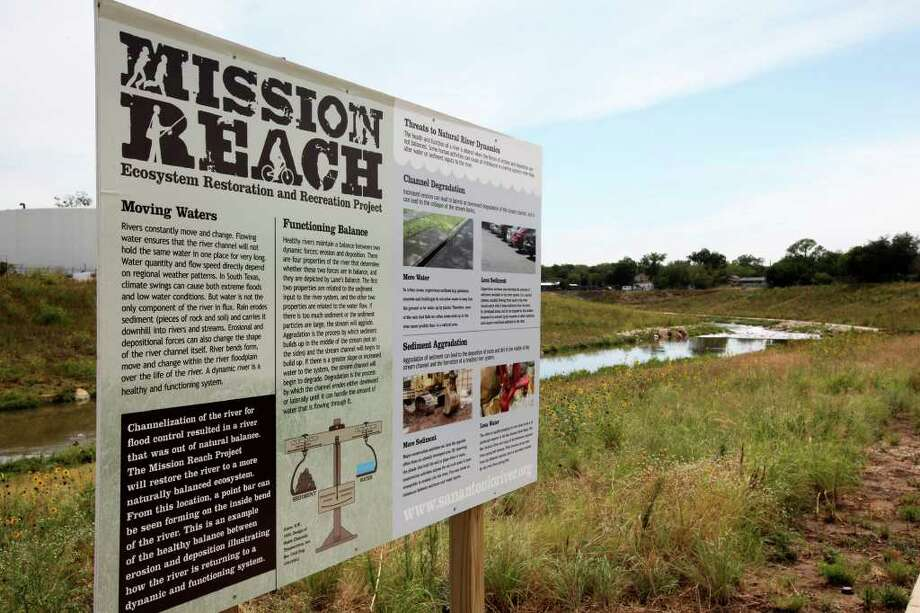 A sign describing the Mission Reach restoration is pictured along the San Antonio River on Wednesday, June 22, 2011. Photo: Andrew Buckley/abuckley@express-news.net / abuckley@express-news.net