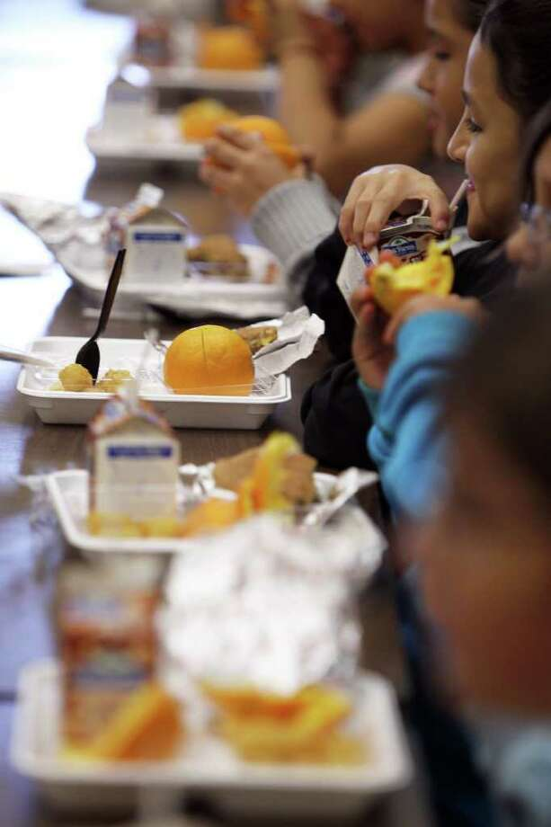 The USDA has directed districts across the country to raise meal prices, in part because of the higher cost of increased portions of vegetables and fruits such as the substantial oranges pictured. Photo: Jennifer Whitney/Special To The Express-News / Jennifer Whitney