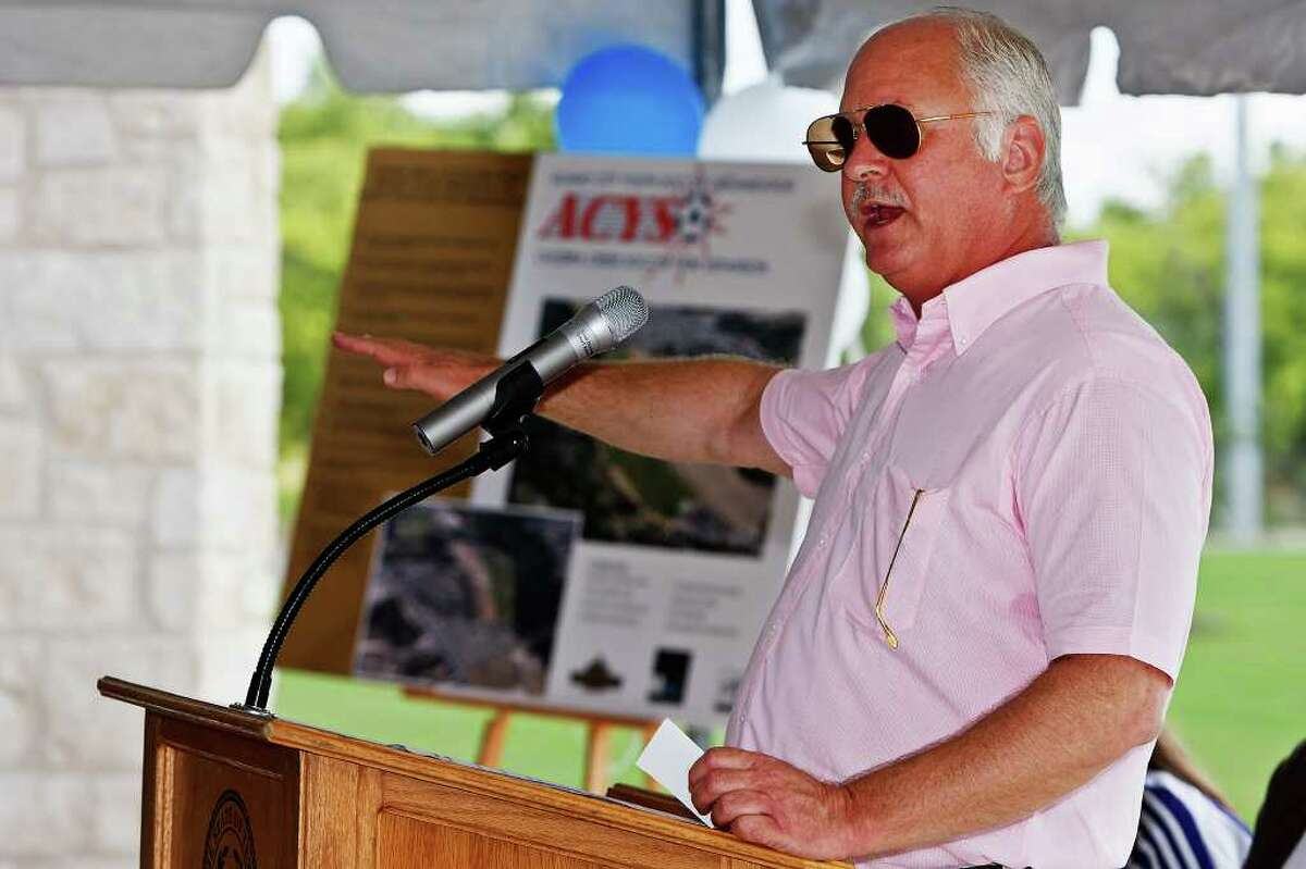 County sports facilities consultant George Block speaks at the opening ceremonies for the $6.2 million Culebra Creek Soccer Park.