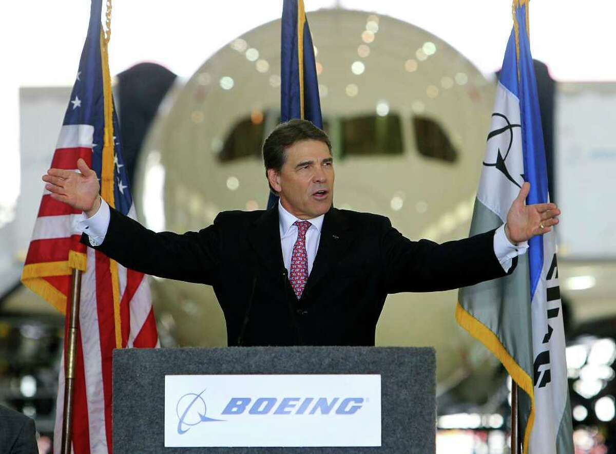 Gov. Rick Perry gestures during a speech prior to signing House Bill 3727 on Thursday, June 23, 2011. The bill effectively gives aircraft manufacturers like Boeing to appraise the value of their aircraft while under construction at 10 percent of its market value.