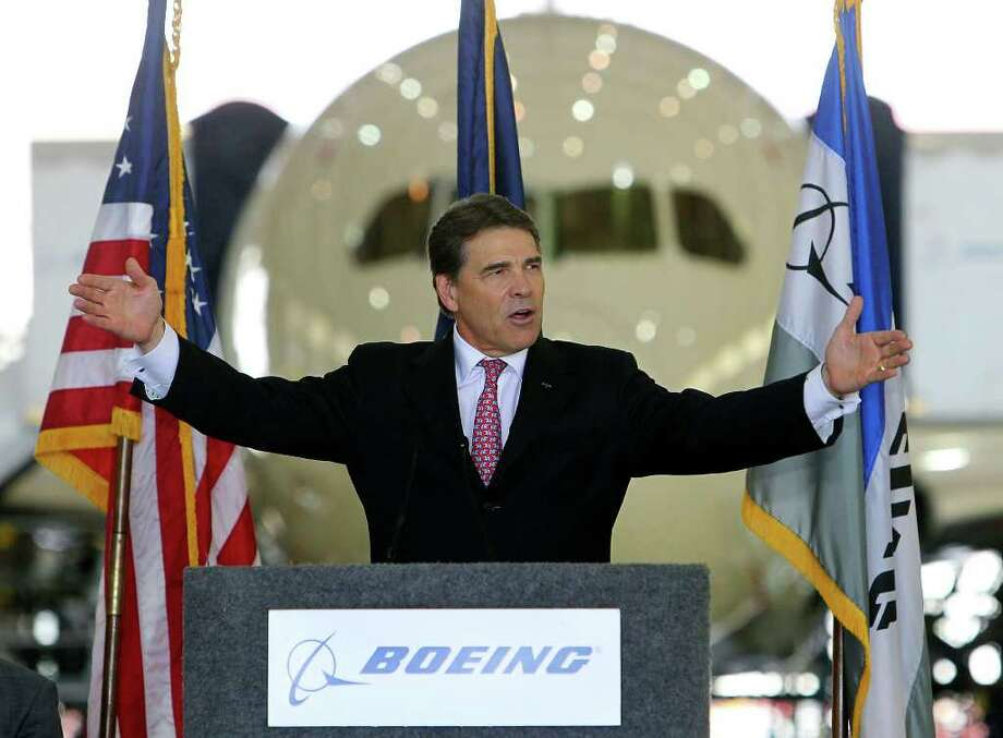 Gov. Rick Perry gestures during a speech prior to signing House Bill 3727 on Thursday, June 23, 2011. The bill effectively gives aircraft manufacturers like Boeing to appraise the value of their aircraft while under construction at 10 percent of its market value. Photo: Kin Man Hui/khui@express-news.net / kmhui@express-news.net