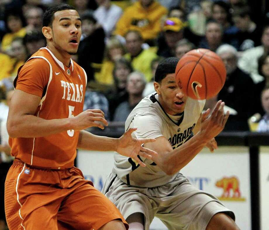 Colorado guard Andre Roberson, right, takes the ball away from Texas guard Cory Joseph (5) during  an NCAA college basketball game in Boulder, Colo., on Saturday, Feb. 26, 2011. Colorado beat Texas 91-89. (AP Photo/ Ed Andrieski) Photo: Associated Press