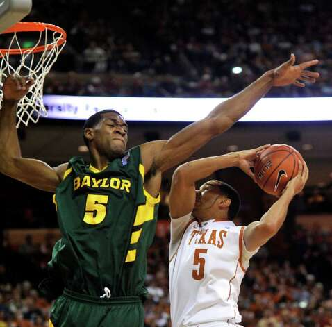 Baylor forward Perry Jones III, left, blocks the shot of Texas guard Cory Joseph during the first half of an NCAA college basketball game, Saturday, Feb. 12, 2011, in Austin, Texas. (AP Photo/Michael Thomas) Photo: Associated Press