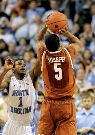 Texas' Cory Joseph (5) takes the game-winning shot as North Carolina's Dexter Strickland (1) defends in the final seconds of Texas' 78-76 win in an NCAA college basketball game in Greensboro, N.C., Saturday, Dec. 18, 2010. (AP Photo/Chuck Burton) Photo: Associated Press