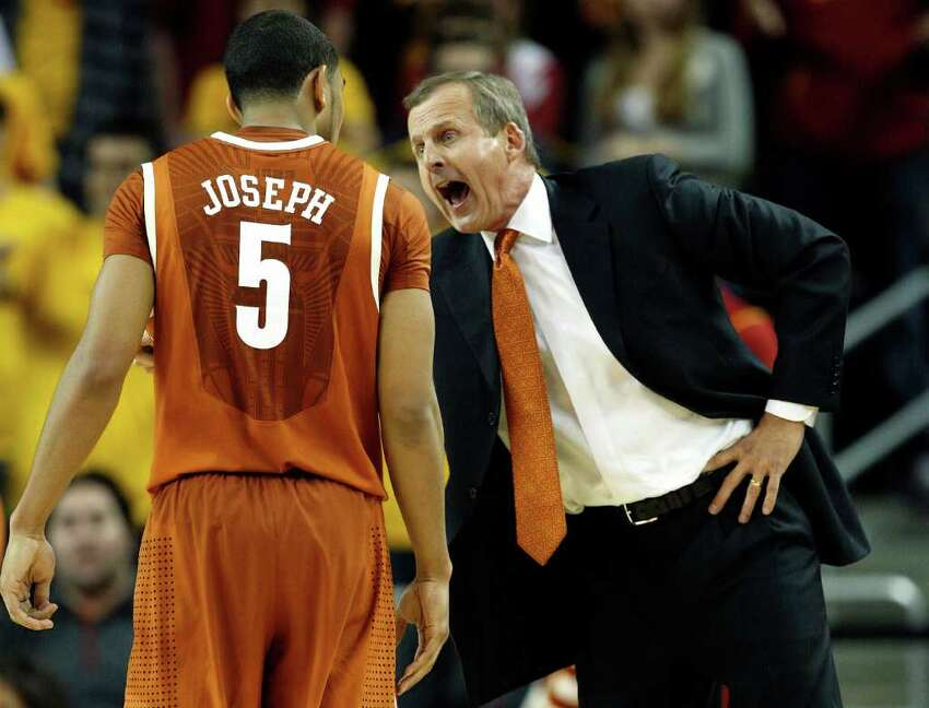 Texas head coach Rick Barnes, right, talks to guard Cory Joseph during the second half of an NCAA college basketball game against Southern California in Los Angeles, Sunday, Dec. 5, 2010. Southern California won 73-56. (AP Photo/Jason Redmond)