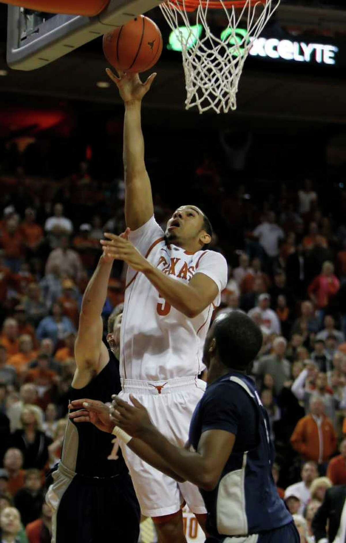Texas' Cory Joseph (5) goes for a shot against Rice during an NCAA college basketball game in Austin, Texas, Saturday, Nov. 27, 2010. Joseph was Texas high-scorer with 14 points. Texas defeated Rice 62-59. (AP Photo/Erich Schlegel)