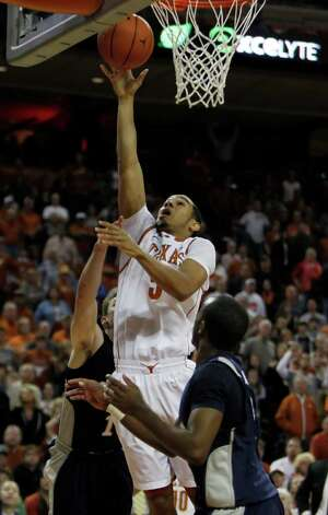 Texas' Cory Joseph (5) goes for a shot against Rice during an NCAA college basketball game in Austin, Texas, Saturday, Nov. 27, 2010.  Joseph was Texas high-scorer with 14 points. Texas defeated Rice 62-59. (AP Photo/Erich Schlegel) Photo: Associated Press