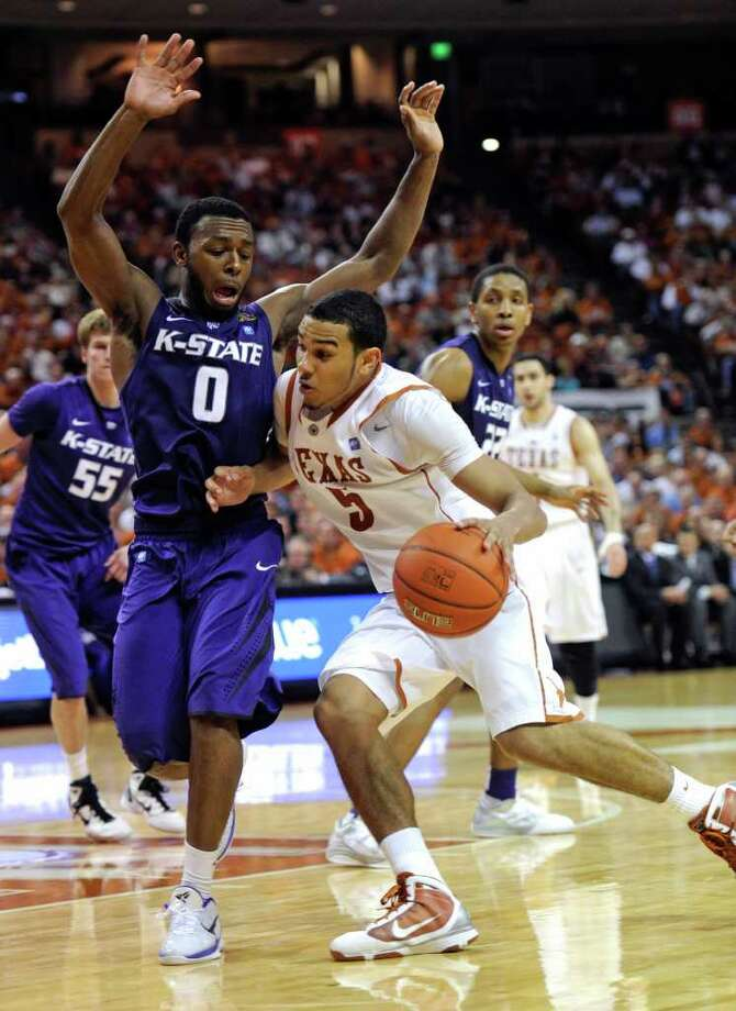 Texas guard Cory Joseph, right, drives on Kansas State guard Jacob Pullen during the second half of an NCAA college basketball game Monday, Feb. 28, 2011, in Austin, Texas.  Kansas State won 75-70. (AP Photo/Michael Thomas) Photo: Associated Press