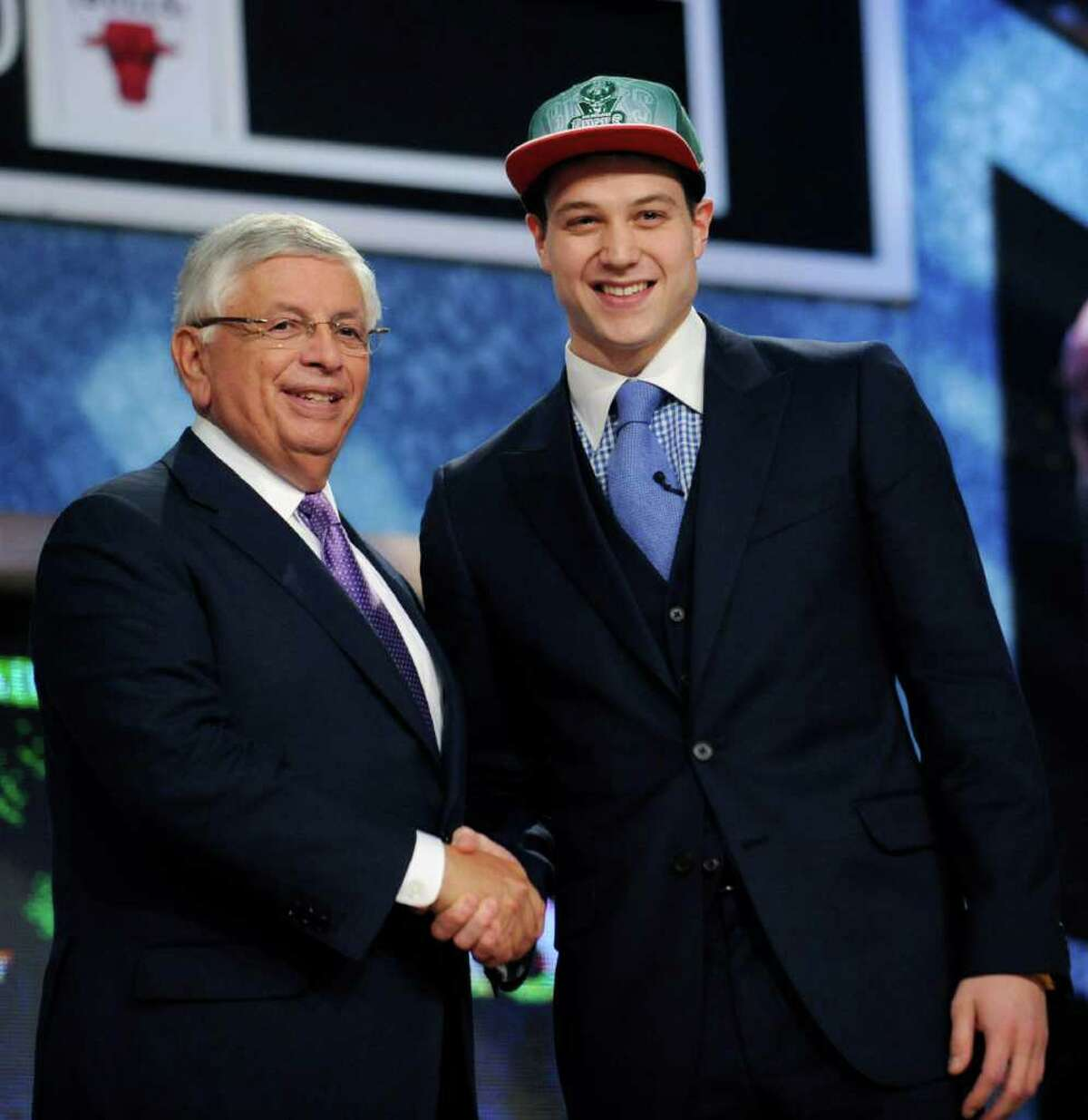 CORRECTS PHOTOGRAPHER - NBA Commissioner David Stern, left, poses with BYU's Jimmer Fredette, who was selected by the Milwaukee Bucks with the No. 10 pick in the NBA basketball draft Thursday, June, 23, 2011, in Newark, N.J.