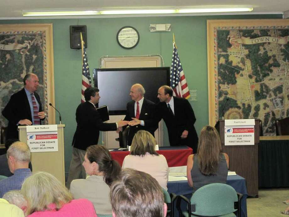 First Selectman candidates Rob Mallozzi and Paul Giusti shake hand at the end of their second debate sponsored by the Republican Town Committee. Photo: Paresh Jha / New Canaan News
