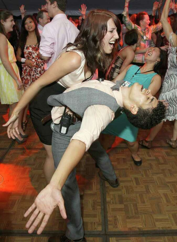 Jacob's Pillow interns Katie Watkins and Anthony Rosado go all out on the dance floor during the Jacob's Pillow 2011 Season Opening Gala.  (Photo by Joe Putrock/Special to the Times Union) Photo: Joe Putrock / Joe Putrock
