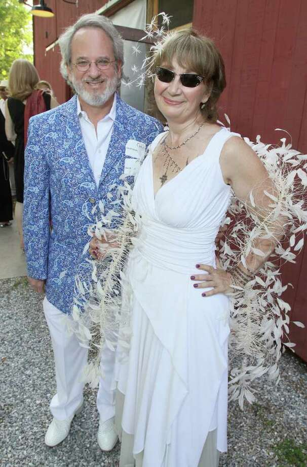 Beckett, MA - June 18, 2011 - (Photo by Joe Putrock/Special to the Times Union) - David Schecker(left) and Vicki Bonnington(right), wearing Chanel temporary tattoos and a Giorgio Armani boa, arrived in style for the Jacob's Pillow 2011 Season Opening Gala. Photo: Joe Putrock / Joe Putrock