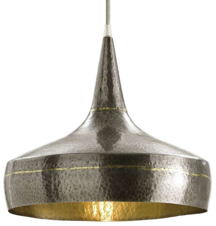 Arteriors' hanging lamp of hammered metal is $295 at High Fashion Home, www.highfashionhome.com. Photo: Arteriors Home