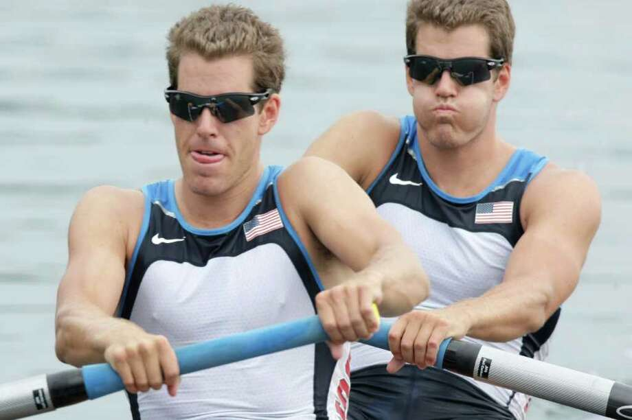 USA's Cameron Winklevoss, left, and twin brother Tyler, Greenwich natives, take the start of their men's pair repechage at the Beijing 2008 Olympics in 2008. (AP Photo/Gregory Bull) Photo: Contributed Photo / AP