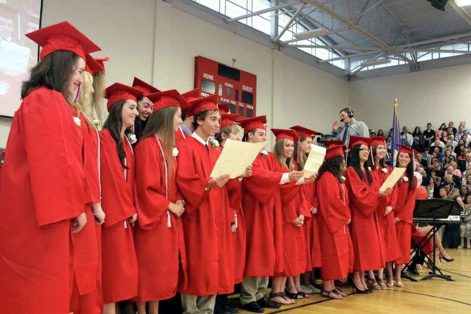 "Pomperaug senior chorale members perform ""On My Way"" during Thursday night's commencement exercises. Photo taken 06/23/11 Photo: Walter Kidd / The News-Times Freelance"