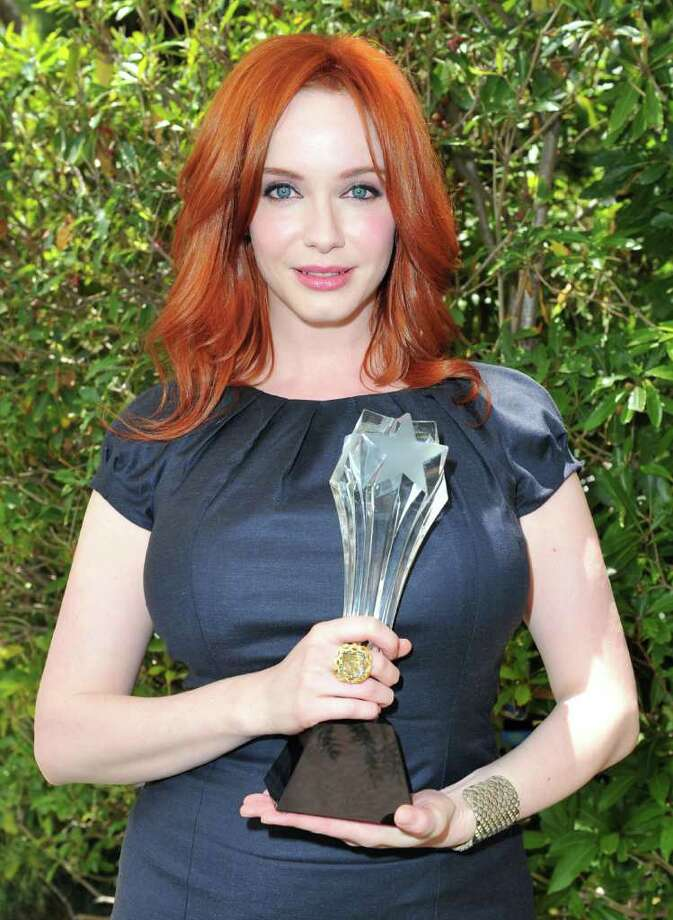 "From bold and bright to deep, dark and beautiful -- these celebs can make any shade of red look hot. Actress Christina Hendricks, one of the stars of ""Mad Men"", is currently one of the most famous redheads in Hollywood. Here are a few more.  Photo: Alberto E. Rodriguez, Getty Images For The Broadcast T / 2011 Getty Images"