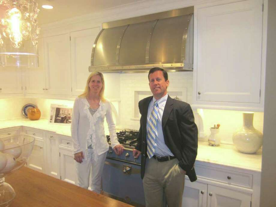 Kitchens by Deane is celebrating 50 years of doing business in New Canaan this year. In the company's Elm Street showroom is brother and sister managing team Carrie Deane Corcoran and Peter Deane. - Photo by John H. Palmer Photo: File Photo / New Canaan News