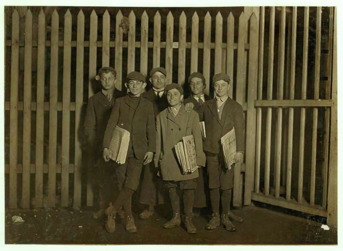 Early 1900's: In early 1900s, a group of boys selling papers at