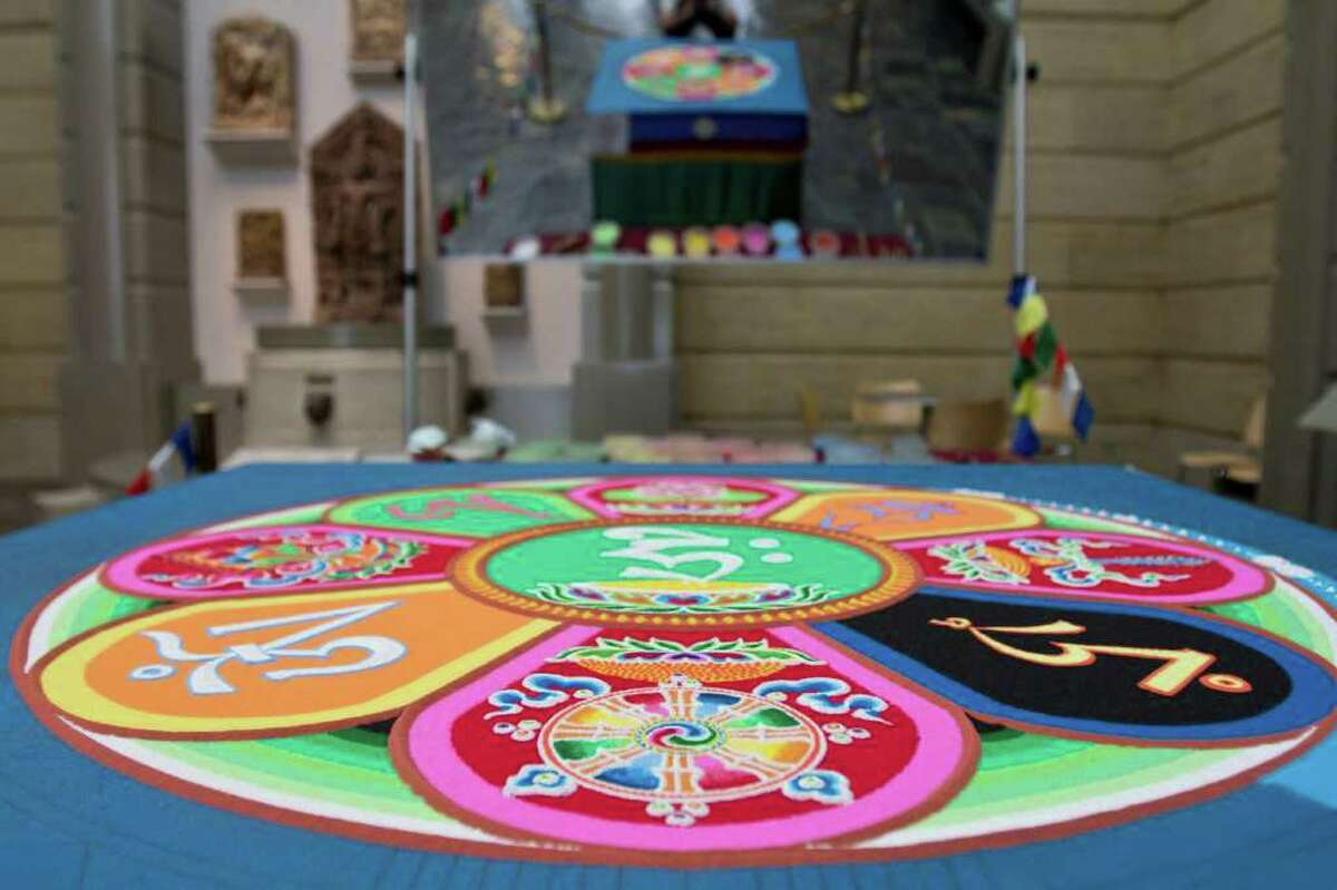 A Sand Mandala created by six Gaden Shartse Monks over a period of a couple days at the Seattle Asian Art Museum Thursday. Once it is finished it will be swept away. The Mandala symbolizes