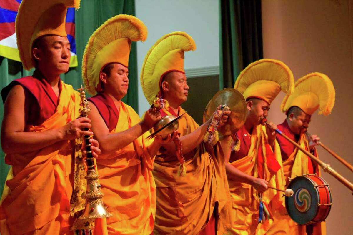 Gaden Shartse Monks, from a monastery in Karnataka, India, perform the