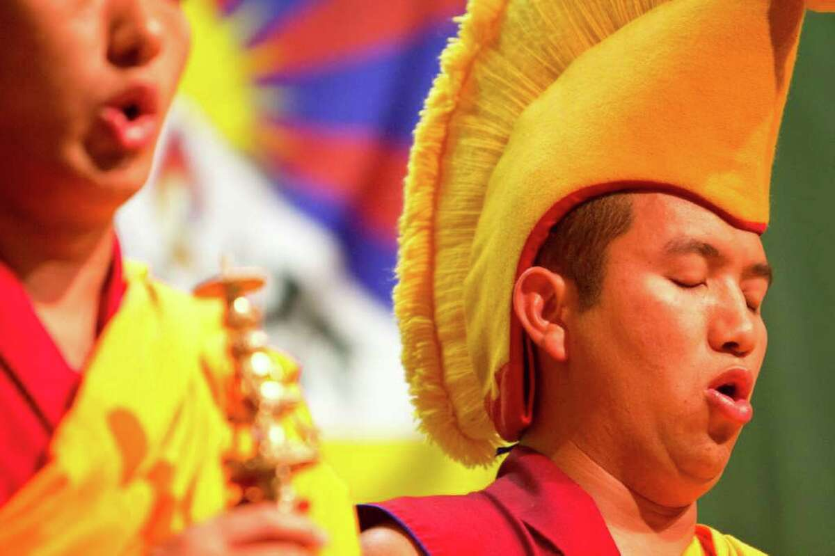 Gaden Shartse Monks, from a monastery in Karnataka chant on stage at the Seattle Asian Art Museum Thursday.
