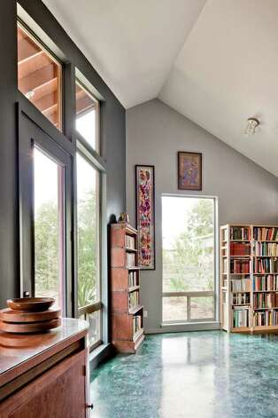 The study at the rear of the house has extensive windows to allow for views to the backyard. Photo: CHRIS COOPER/ SPECIAL TO THE EXPRESS-NEWS / © 2010 Chris Cooper all rights reserved