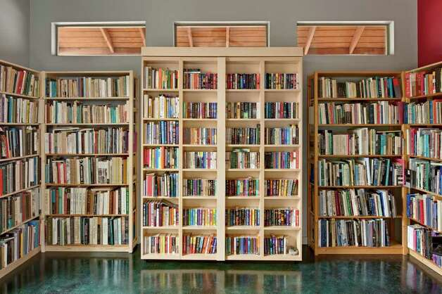 This section of shelving in the study disguises a murphy bed, used by overnight visitors. Photo: CHRIS COOPER, CHRIS COOPER/ SPECIAL TO THE EXPRESS-NEWS / © 2010 Chris Cooper all rights reserved