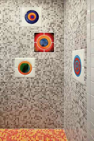 The shower features recycled art glass. Photo: CHRIS COOPER/ SPECIAL TO THE EXPRESS-NEWS / © 2010 Chris Cooper all rights reserved