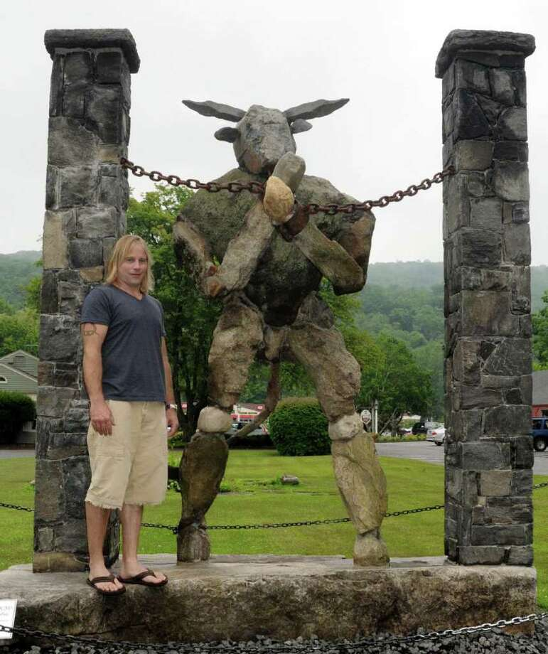 Sculptor Joseph Jaskolka, of New Milford, stands with one of his stone sculptures, Minotaur Bound, that is installed at the Seti Gallery in Kent on Wednesday June 22, 2011. Photo: Lisa Weir / The News-Times Freelance