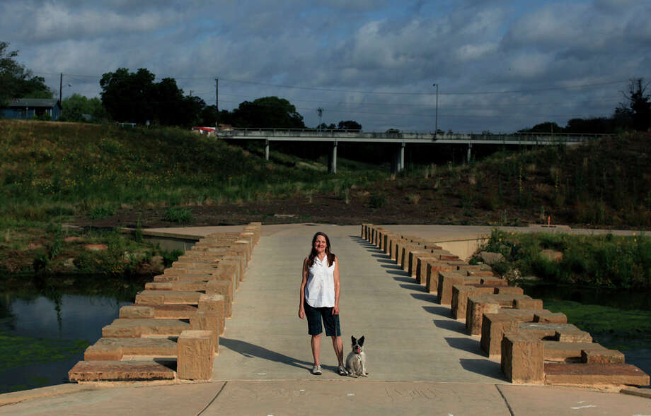"Artist Anne Wallace calls her work on the pedestrian bridge near Concepcoin Park ""The Once and Future River."" LIZA KRANTZ / EXPRESS-NEWS / SAN ANTONIO EXPRESS-NEWS"
