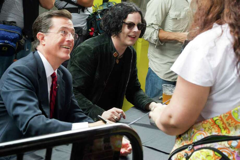 "Stephen Colbert, left, and Jack White sign copies of their vinyl record, ""Charlene II (I'm Over You),""  in New York, Friday, June 24, 2011. Colbert debuted his new Jack White-produced single on ""The Colbert Report"" on Thursday night. (AP Photo/Charles Sykes) Photo: Charles Sykes"