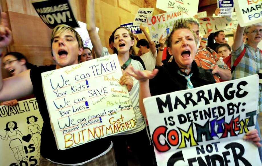 Marci Tebbano of Schenectady, left, Kristin Sorbaro of Albany, center, and Danielle Gannon of Albany join others as they express their opinion about same sex marriage on Friday, June 24, 2011, at the Capitol in Albany, N.Y. (Cindy Schultz / Times Union) Photo: Cindy Schultz