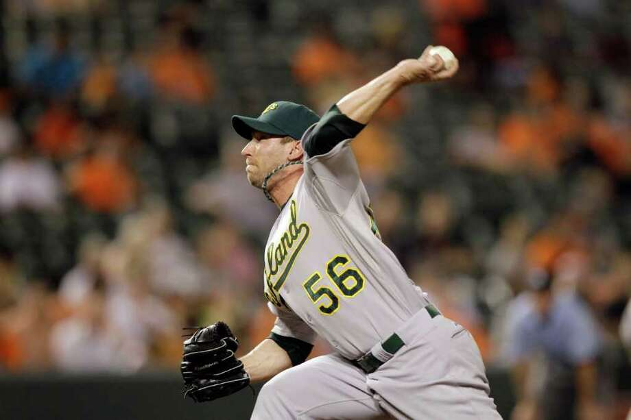 BALTIMORE, MD - JUNE 07: Pitcher Craig Breslow #56 of the Oakland Athletics delivers to a Baltimore Orioles batter at Oriole Park at Camden Yards on June 7, 2011 in Baltimore, Maryland.  (Photo by Rob Carr/Getty Images) Photo: Rob Carr, Getty Images / 2011 Getty Images